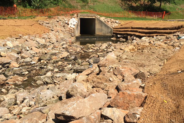 construction progress photo showing stream inlet with terracing to prevent erosion